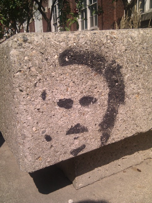 Graffiti French face on concrete bench outside of the Armory at the University of Illinois Campus