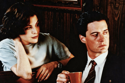Audrey and Agent cooper look to screen right.