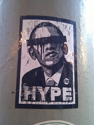 President Obama with a bar over his eyes and the word HYPE.